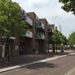 Foto van de zijkant van het Kloosterplein, gezien vanaf de Tilburgseweg
